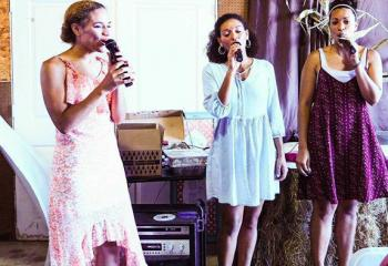 Sing For America shares its gift of music at the shower, from left, Teara, Tasia and Taryn Gilbert