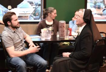 Bobby Campanella, left, parishioner of St. Nicholas, Walnutport, chats with Sister Geralyn Schmidt during the break.