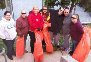 Having fun participating in the Great American Cleanup are, from left, case manager Ashley Blake, Lisa Painter, Caitlin Kasperowicz, Catina Mejia, Sara Dehaven, Autumn Yerger and Mary LaPrad.