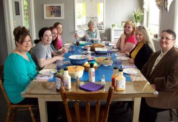 Gathered for Easter dinner are, from left, Catina Mejia, Sara Dehaven, Autumn Yerger, Mary LaPrad, Sister of Mercy Chris Seghetti, Caitlin Kasperowicz, Lisa Painter and Christina Wilson.