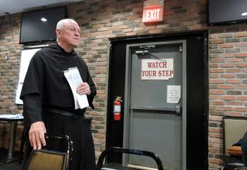 "Augustinian (OSA) Father Arthur Purcaro listens to a question while presenting the Theology on Tap session ""The Lost Art of Listening."""
