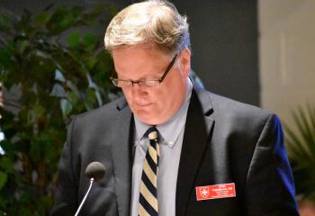 Malta member John Turnbach serves as lector during the first reading.