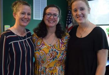 Little, center, is welcomed by Annie Sarlo, left, interim secretary of the Secretariat for Catholic Life and Evangelizaton, and Abby Lutz.