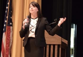 "Dr. Brooke Tesche, chancellor for Catholic education, addresses educators at the conference, which had the theme ""Inspiring Souls, Transforming Minds."""