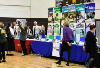 Educators attending the event browse more than 40 vendor exhibits.