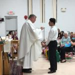D'Angelo Lopez received First Communion from Fr. Winne on May 12, 2017.