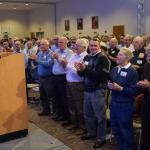 "Father Bernard Ezaki, assistant pastor of St. Jane Frances de Chantal, Easton, receives a standing ovation after his presentation, ""Sinfulness: The Challenges Men Face Living in the Spirit."" (Photos by John Simitz)"