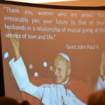 A slideshow features a quote from St. John Paul II.