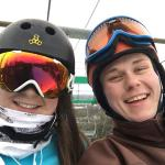 Zachary Wehr, right, diocesan seminarian, spends time with his sister, Emily, during a ski trip.