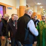 Bishop Schlert introduces himself to men attending the conference after Mass.